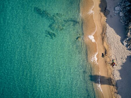 Beautiful beach with family top aerial view drone shot, Sithonia, Greece 写真素材