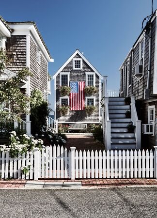 United States flag at suburban neighborhood. Provincetown, Cape Cod, Massachusetts, USA. Reklamní fotografie