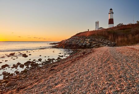 Montauk Lighthouse and beach at sunrise, Long Island, New York, USA.
