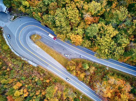 Scenic Mohawk Trail highway hairpin turn in autumn, Massachusetts, USA. Fall in New England. Aerial drone shot. Stock Photo