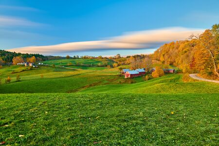 Jenne Farm with barn at sunny autumn morning in Vermont, USA