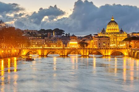St. Peter's cathedral and Tiber river with high water at evening. Saint Peter Basilica in Vatican city with Saint Angelo Bridge in Rome, Italy Фото со стока