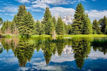 Grand Teton Mountains from Schwabachers Landing on the Snake River at morning. Grand Teton National Park, Wyoming, USA.