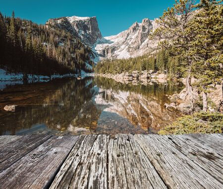 Dream Lake and reflection with mountains in snow around at autumn. Rocky Mountain National Park in Colorado, USA. Stock Photo