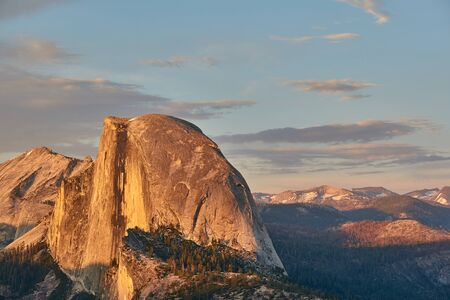 Half Dome rock formation close-up in Yosemite National Park summer sunset view from Glacier Point. California, USA.
