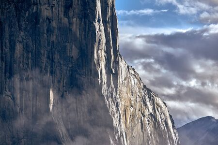 El Capitan rock close-up in Yosemite National Park Valley at cloudy autumn morning from Tunnel View. Low clouds lay in the valley. California, USA. Stock fotó