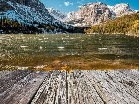 The Loch Lake with rocks and mountains in snow around at autumn. Rocky Mountain National Park in Colorado, USA.
