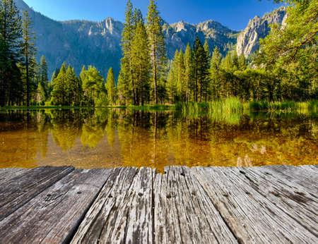 Cathedral Rocks reflecting in Merced River at Yosemite National Park. California, USA. Imagens