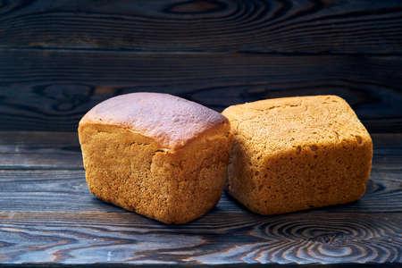 Freshly baked homemade bread on dark wooden table