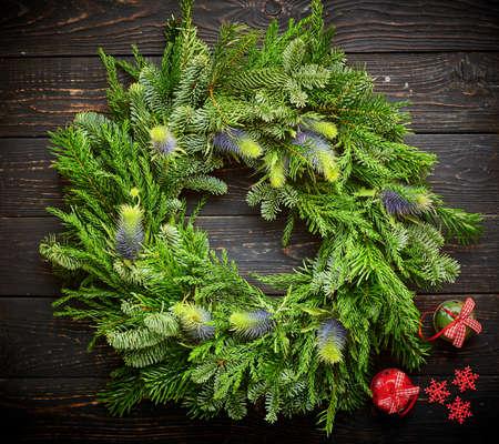 Christmas wreath on dark rustic wooden background