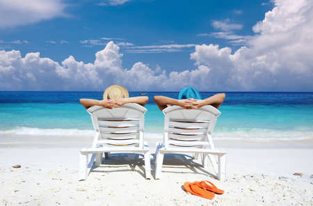 Couple on a tropical beach Stock Photo