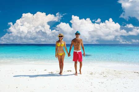 Couple walking on a tropical beach. Perhentian islands, Malaysia.