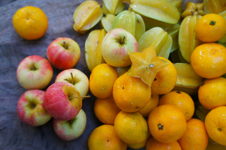 Starfruits apples and oranges photo