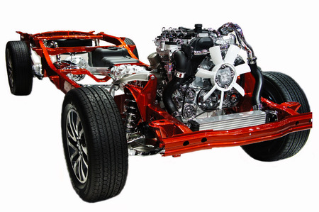 Car chassis with engine isolated on white
