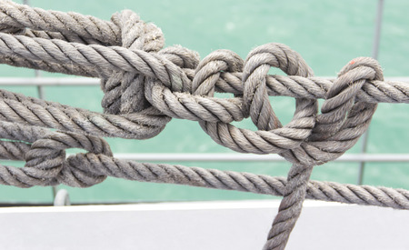 ROPE IN A SHIF AT THE SEA  Stock Photo