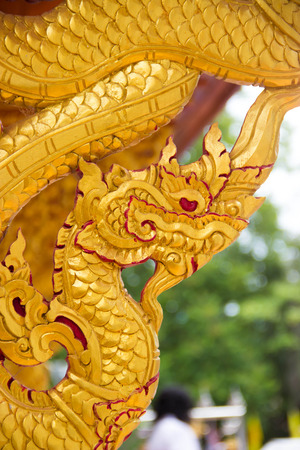 Carving wood the king of Nagas