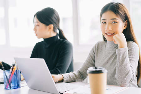 two asian business women are gathered in the office Standard-Bild