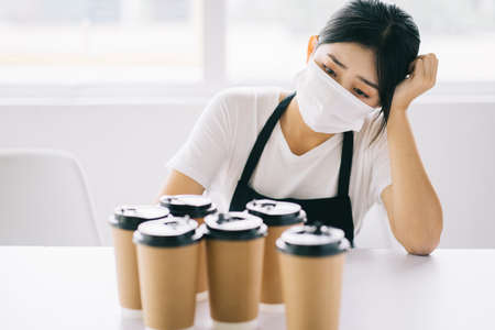 The Asian coffee shop owner is upset because their shops were closed due to the effects of the disease