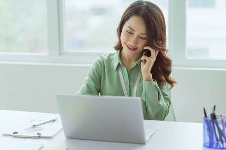 Beautiful Asian businesswoman sitting working at office