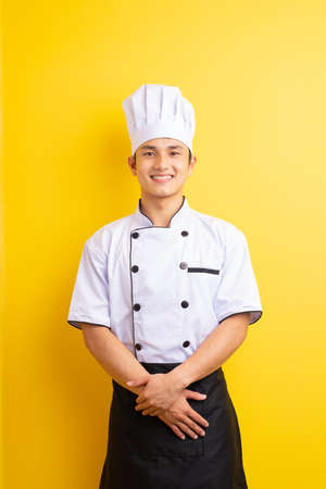 Image of Asian male chef on yellow background