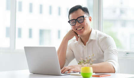 Image of Young Asian businessman working at office