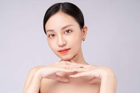 Beautiful Asian woman feels happy with beautiful healthy skin