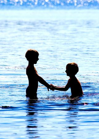 game in water of two friends