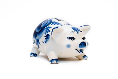 Coin box in the form of a pig from porcelain on a white background (isolated) Stock Photo