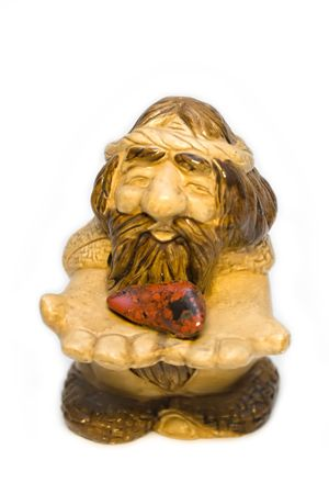 Figurine of the old man with stone heart in hands Stock Photo