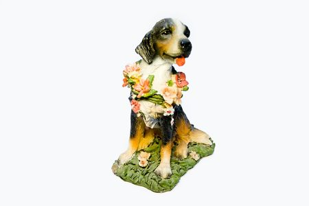 Ceramic dog with a flower collar on a white background