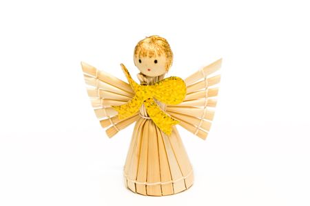 The angel made of straw, with the big gold bow