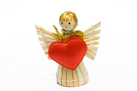 The angel made of straw, with the big gold bow and red heart in hands