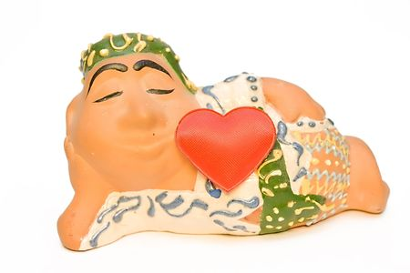 Ceramic figure of east young man with the big red heart