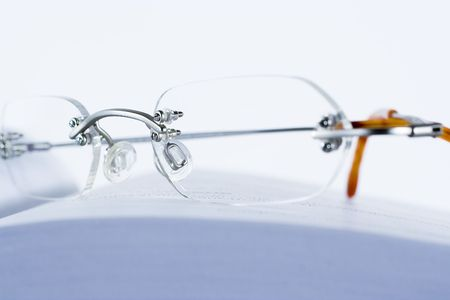 glasses laying on the open book