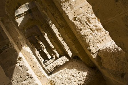 Old corridor of an amphitheatre in a sunlight Stock Photo
