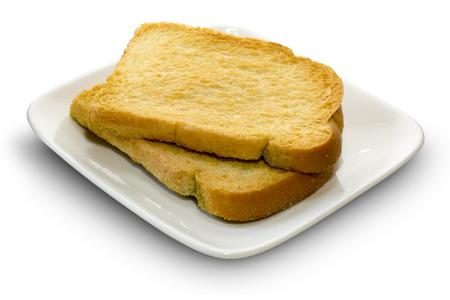 biscotte: Rusk sur une assiette blanche Banque d'images