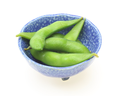 Green soybeans in a blue bowl photo