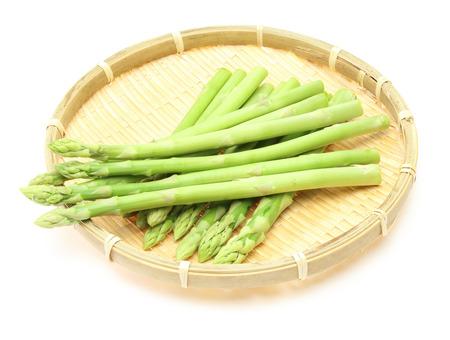 a colander: Asparagus on a bamboo colander Stock Photo