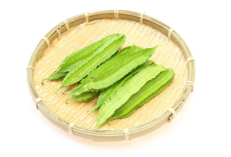 winged: Winged bean on a bamboo colander