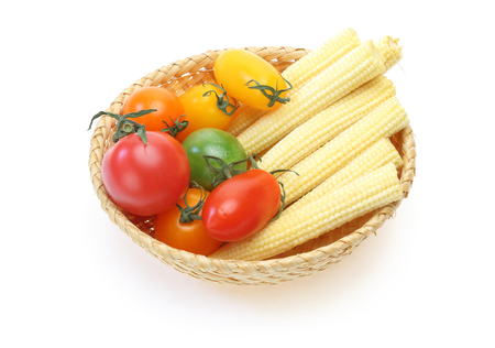 baby corn: Grape tomato and baby corn in a basket Stock Photo