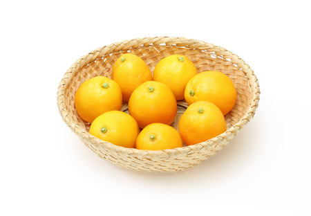 cumquat: Kumquats in a basket Stock Photo