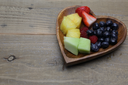 shaped: Cut fruits in heart shaped plate
