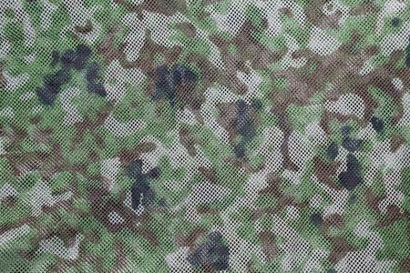 camouflaged: Camouflaged fabric background