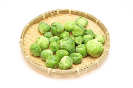a colander: Brussels sprouts on a bamboo colander