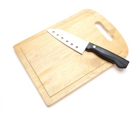 cuchillo de cocina: Kitchen knife and cutting board Foto de archivo