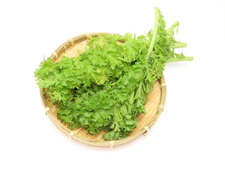wasabi: Wasabi greens on a bamboo colander