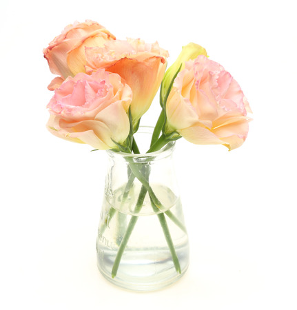 gentian flower: Bouquet of eustoma in a glass bottle Stock Photo
