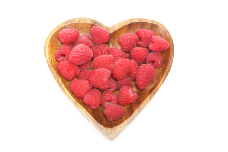 shaped: Raspberry in a heart shaped plate