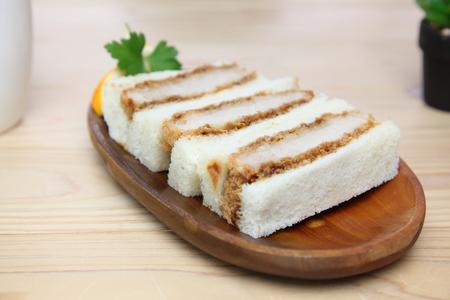 pork cutlet sandwich on a wooden plate