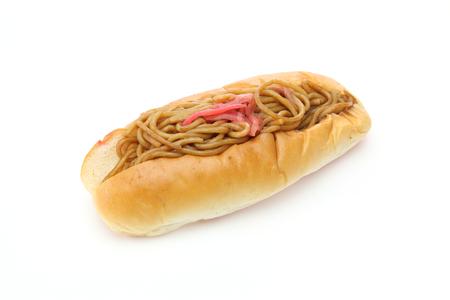yakisoba on a Hotdog bun in a white background